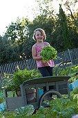 Little girl in a kitchen garden