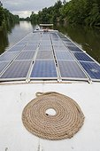 Solar panels on a barge on the River Lot France  ; Solar water heater