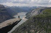 Trolltunga rock overlooking the empty 600 m in Norway