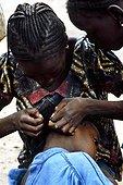 Delousing between girls Djenne Mali