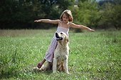 Girl playing with a Golden Retriever Provence France