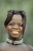 Portrait of a young girl Himba Kaokoveld Namibia  ; Himba girl with the typical double plait hairstyle of the pre-adolescent girls.