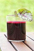 Red beet juice on a garden table