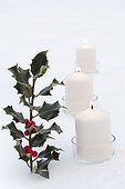 holly and candles on a table