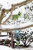 Bird shelter in a garden under snow
