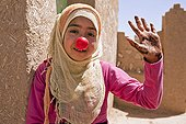 Young girl in the village of Khamlia with a clown nose Morocco