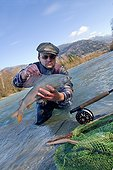 Fly fishing for grayling River Drau Hight Tyrol Austria ; Fly fishing on alpine river
