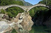 Switzerland ; Ponte dei Salti, historic Roman bridge with double arches crossing the Verzasca River. Verzascatal, Lavertezzo, Ticino, Switzerland, Europe