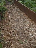 Mulching summer in an organic garden France ; Woodchips