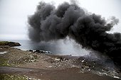 """Fire in open dump Saint-Pierre and Miquelon ; Nothing is done to disappear both foul landfills open always present in Saint-Pierre and Miquelon, and in addition to disfigure the landscape and pollute convey a very unflattering picture of the archipelago. Sorting waste is non-existent in Saint-Pierre and Miquelon, the entire cast is loose in these discharges and partially burned in the open, of course without the slightest fume filtration, when the winds are oriented towards the sea, and not to the islands or to their Canadian friends in Newfoundland. Going through these discharges, walking on layers of accumulated waste for decades, burned or not, more or less polluting and biodegradable. A composting plant was built close to the """"Dampe"""" Saint-Pierre. But no manager in sight, and the building is for the moment completely unused. Besides the excitement of the most lucrative projects, preservation of the environment is a minor concern in Saint-Pierre and Miquelon, or deeply rooted habits do not change easily."""