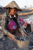 Woman and basket of coal mine salt Kohk Saath Laos