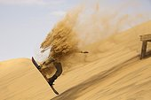 Sand boarding in the dunes of the Namib Desert