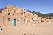 Community House in the Indian village of Taos Pueblo ; Millennium Village of Pueblos Indians built in adobe