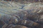 California Death valley National Park ; The eroded badlands of Gower Gulch below Zabriskie Point at dawn. Death Valley National Park, California, USA.