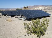 California Death Valley National Park ; Solar panels in the immediate vicinity of the Furnace Creek Visitor Center in the Death Valley. Death Valley National Park, California, USA.