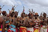 Rendille men in traditional dress Kenya ; They are nomads who tend camels, sheep, goats and cattle.