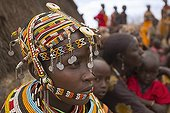 Rendille girl in traditional dress Kenya ; They are nomads who tend camels, sheep, goats and cattle.