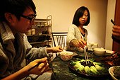 Couple enjoying a dish of sea cucumber China ; Despite the unappetizing appearance for a Western, this dish is very popular in Asia.