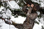 Bow hunter on the lookout in winter PNR Chartreuse France