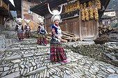 Long Skirt Miao women in traditional dress - Guizhou China