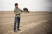 Boy and Egyptian Kite at the edge of the road - Morocco