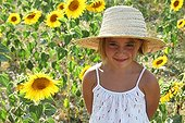 Girl in a field of sunflowers in bloom - France