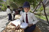 Schoolboy doing outdoor classroom - Himalaya India  ; Jammu and Kashmir