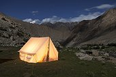 Tent lit night - Nubra Valley Ladakh Himalaya India  ; Tent candlelit located inside