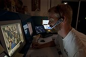 """Aquarius Reef Base control room  - Floride  ; Saul Rosser, Operations Director ARB/UNCW. Shore Base Aquarius monitoring station """"watch desk"""", fast response and workboats, small boats for daily operations, dive lockers, workshops, dormitory, wet and dry laboratories, and emergency recompression chamber."""