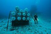 Insspection high pressure air - Aquarius Reef Base Florida ; umbilical diver inspecting the high pressure air reserve