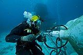 Cleaning high pressure air - Aquarius Reef Base Florida ; umbilical diver cleaning the high pressure air reserve