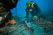 Diver cleaning an anode  - Aquarius Reef Base Florida ; Umbilical diver cleaning an anode