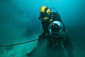 Diver cleaning an anode  - Aquarius Reef Base Florida ; umbilical diver moving a NASA prototype camera