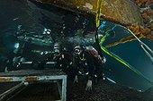 Aquanauts  enter the wet porch - Aquarius Reef Base Florida ; Aquanauts Dr. Chris Martens (l) and Dr. Niels Lindquist (r) enter the wet porch at the end of a night dive