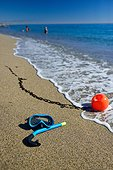 Diving mask and snorkel on a sandy beach - France