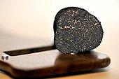 Black truffle cut on mandolin - France