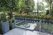 Terrace and pound on an urban garden ; Landscaper: Pierre-Alexandre RISSER<br><br>