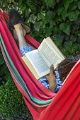 Reading in a garden hammock