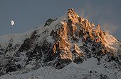 Gibbous moon and Aiguille du Midi at sunset - Alps France