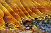 The Painted Hills - John Day Fossil Beds National Monument ; Eroded hills of volcanic ash brightly colored with oxides of iron and manganese, and lignite - tertiary era, to - 25 My