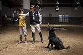 Child listening to the instructions of trust with a dog ; Emmanuel 13 years with cerebral palsy comes to the center every week for 7 years. He now works three pillars of riding Assisi Balance and Jump.<br>Equitherapy in partnership with the AAAEPAD Association and Ariel Pagani équitherapist<br>Asociacion Argentina de Actividades para Ecuestre Discapacitados