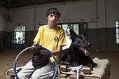 Child suffering from paralysis and dog after exercise ; Emmanuel 13 years with cerebral palsy comes to the center every week for 7 years. He now works three pillars of riding Assisi Balance and Jump.<br>Equitherapy in partnership with the AAAEPAD Association and Ariel Pagani équitherapist<br>Asociacion Argentina de Actividades para Ecuestre Discapacitados