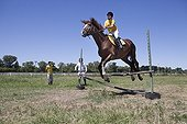 Woman making a jump of horse therapy center ; Equitherapy in partnership with the Association and Ariel AAAEPAD Pagani equithérapist <br>Asociacion Argentina de Actividades para Ecuestre Discapacitados