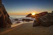 Sun setting on a beach in Corona del Mar - California - USA