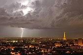 Flash on Paris and Eiffel Tower illuminated at night-France