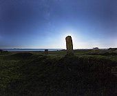 Standing stone hiding the moon in district - Britain France  ; Located Locmariaquer, Dolmen des Pierres-Plates is a covered walkway that opens onto an upright stone.