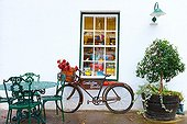 Facade decorated and bicycle - South Africa ; house style Cape Dutch architecture of Dutch inspiration in Stellenbosch, a town famous for its wines