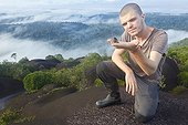Herpetologist and Poison Frog on inselberg - French Guiana