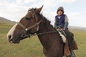 Kyrgyz boy on his horse - Kyrgyzstan