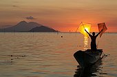 Man fishing with kite at sunset - Pantar Island Indonesia